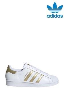 Белые кроссовки с золотистой отделкой adidas Originals Superstar