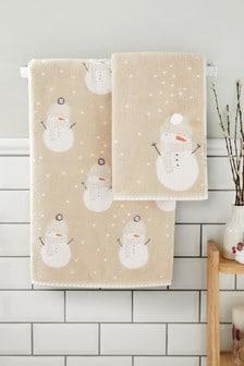 Бежевое полотенце с рисунком снеговиков