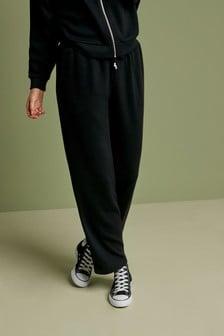 Pantalones de canalé de pernera ancha