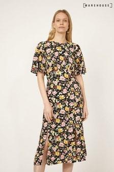 فستان متوسط الطول أسود زهورRiviera منWarehouse