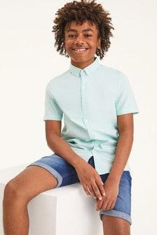 חולצה מכופתרת (גילאי 3 עד 16)