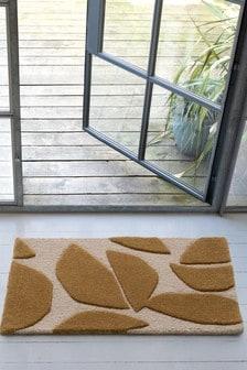 Marie Adeline v Next Courbe Geo Doormat