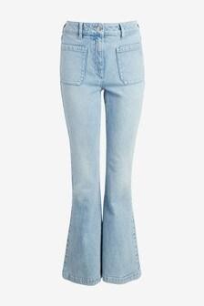 Расклешенные джинсы с карманами спереди