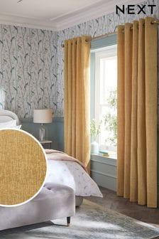 Желто-коричневые плотные шторы из синели с подкладкой и люверсами