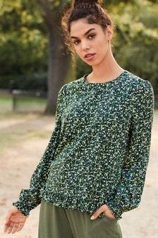 Блузка с длинными рукавами и оборкой по краю