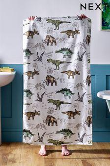 Зеленое полотенце с динозаврами
