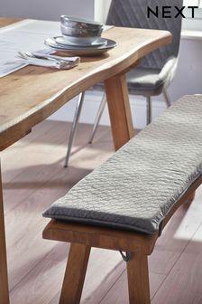 Szara aksamitna poduszka na ławkę