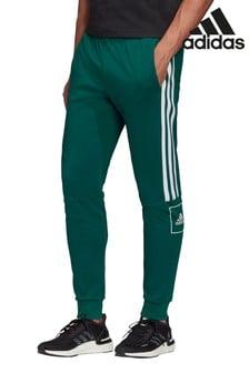 Pantalones de chándal de corte slim en verde con 3 rayas de adidas