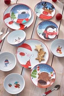 Vajilla de 12 piezas en rojo con diseño de Papá Noel y amigos
