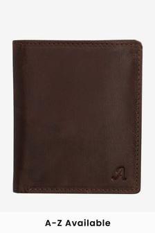 Вместительный кожаный бумажник с монограммой