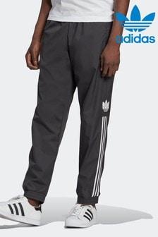 מכנסי חליפת ספורטAdicolor3D Trefoil עם3 פסים שלadidas