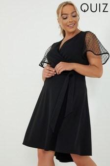 שמלתמעטפתשלQuiz Curve עם שרווליםמנוקדיםושוליים רחבים