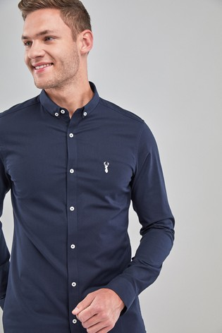 91f23b2b65e7 Buy Navy Skinny Fit Long Sleeve Stretch Oxford Shirt from the Next ...