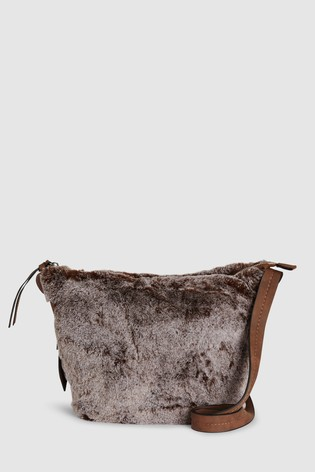 9d7f1aedb7 Buy Chocolate Faux Fur Across Body Bag from Next Ireland