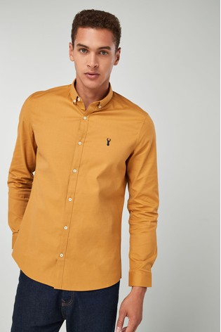 2d4ba8cc37 Buy Ochre Slim Fit Long Sleeve Stretch Oxford Shirt from the Next UK ...