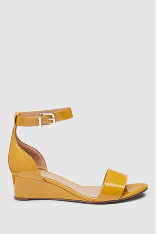 f1fc67d0fc4a Buy Ochre Patent Forever Comfort® Simple Wedges from Next Cyprus