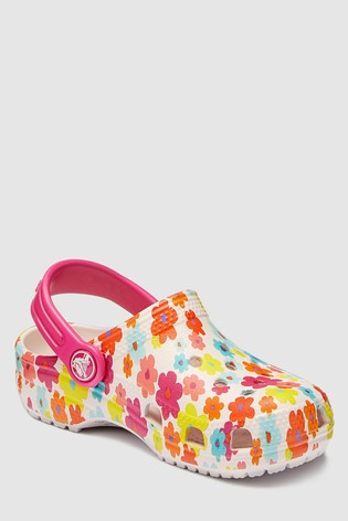 da78b7e37 Buy Crocs™ Barely Pink Floral Print Clog from the Next UK online shop